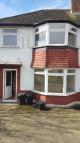 Terraced property in Ripon Gardens, Ilford...