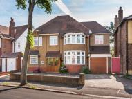 Detached house in Carshalton Park Road...