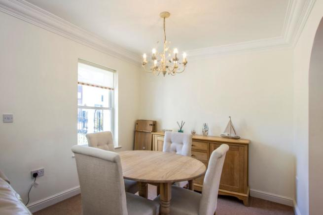 A bright and airy lounge / Dining area with an electric fire place, the room has been decorated to a high standard with neutral walls and soft carpets.