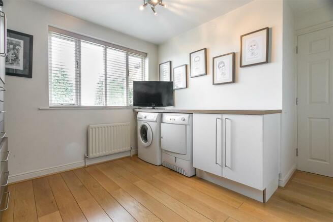Laundry Room/Bedroom Five