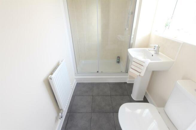 En suite shower room to rear