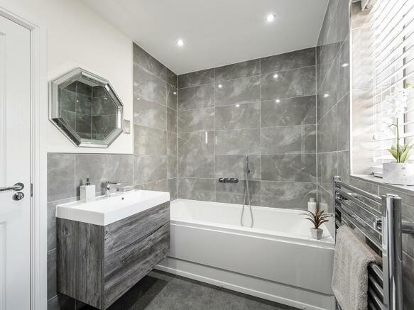 Extensively tiled bathroom