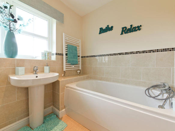 Extensively tiled bathrooms