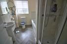 En-suite bath and shower room