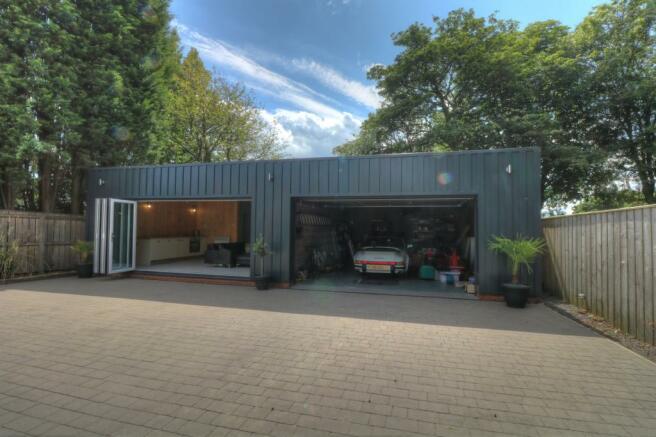 Detached studio flat and garage