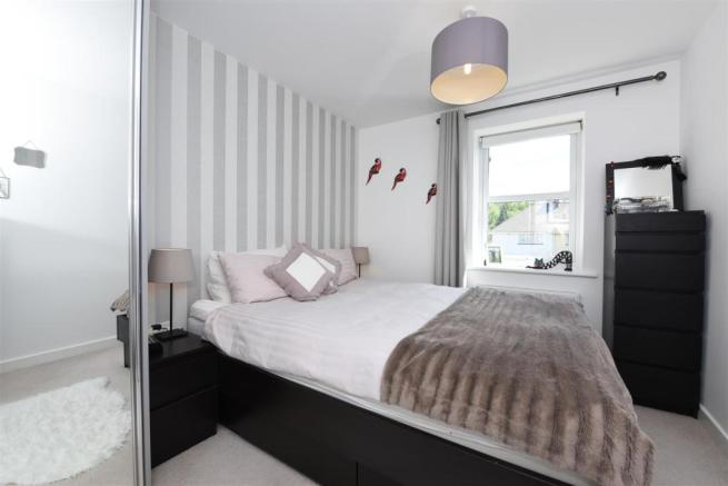 Master bedroom with wardrobes
