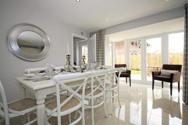 Typical Guisborough dining room with glazed bay and French doors