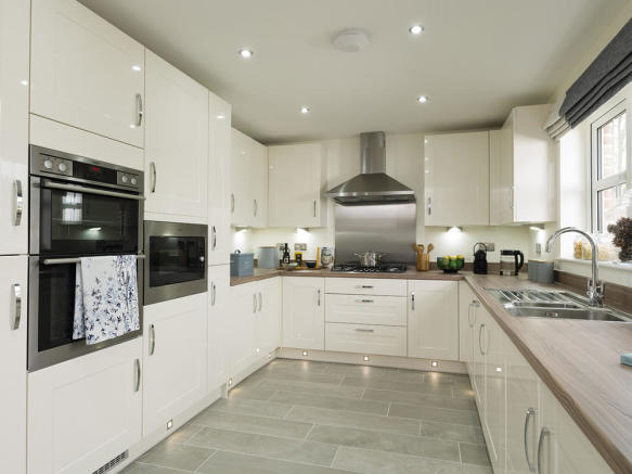 Designer kitchen with integrated appliances and plinth lighting