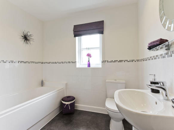 Extensively tiled family bathroom