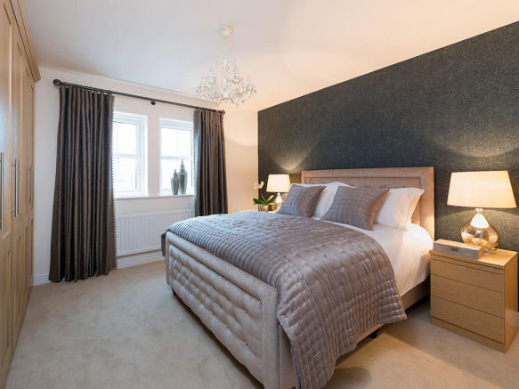 Master bedroom with fitted wardrobes and en-suite