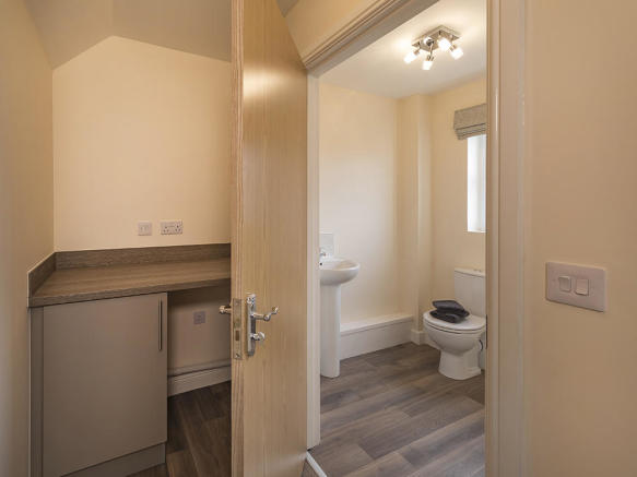 Utility area to kitchen and downstairs WC