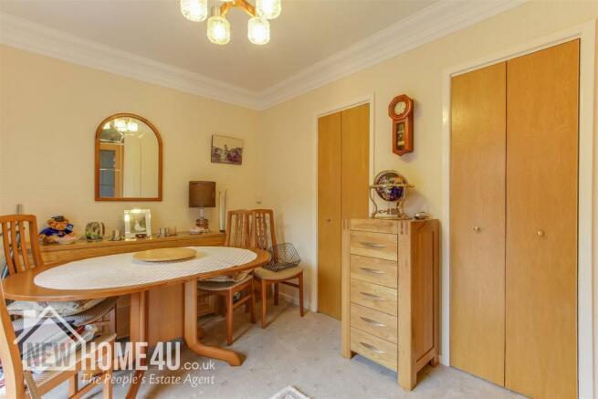 DINING ROOM / BEDROOM THREE: