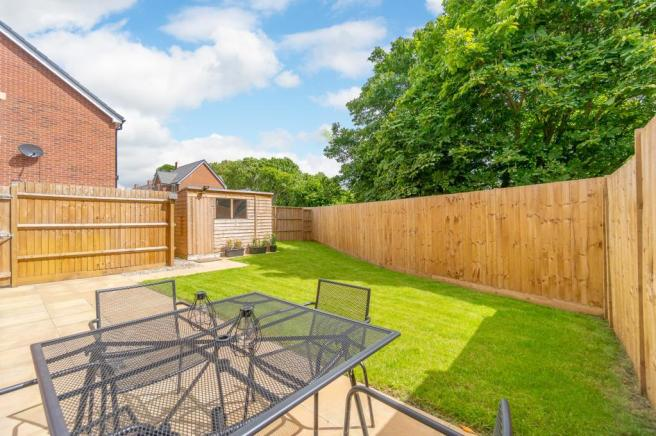 Large rear garden with patio area