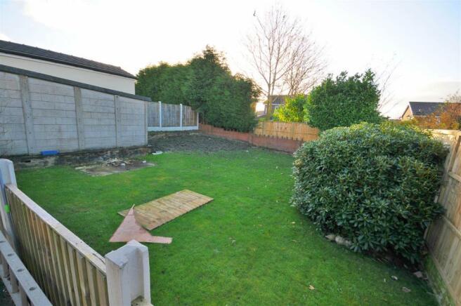 Rear garden, patio and outhouse