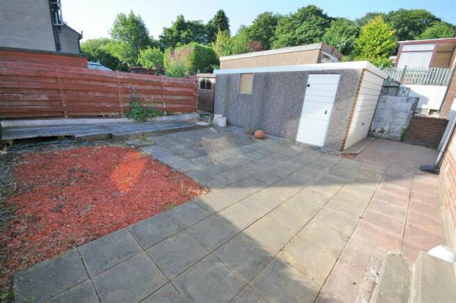 Rear garden, detached garage and carport