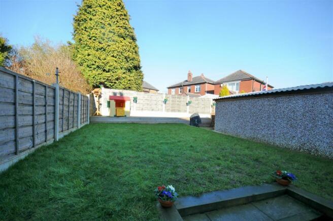 Rear garden, patio and detached garage