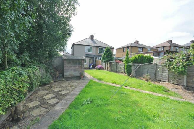 Rear garden / garage and views