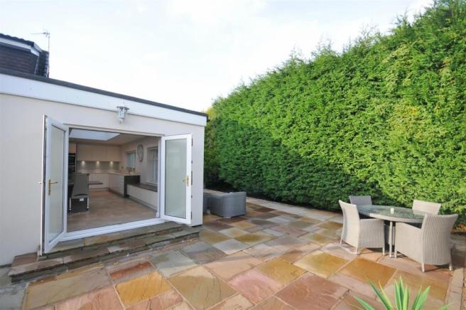 Side and rear gardens and garage