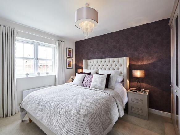 Spacious double bedroom with en-suite shower room
