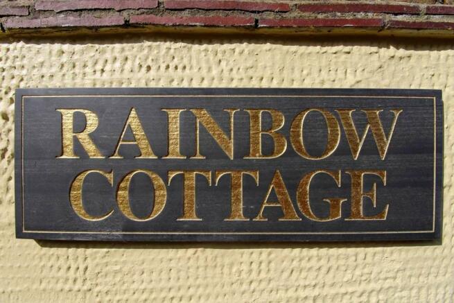 Rainbow Cottage Plaq