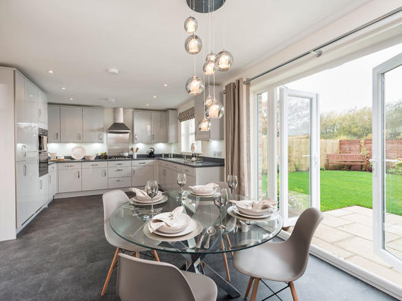 Open plan kitchen/dining area with bi fold doors to the outside