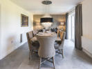 Dining/family room with bi-fold doors to rear garden