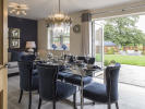 Dining/family room with bi-fold doors to patio area