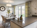 Dining area with bi-fold doors leading to rear garden