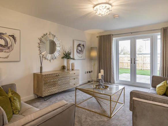 Spacious lounge with french doors to rear garden