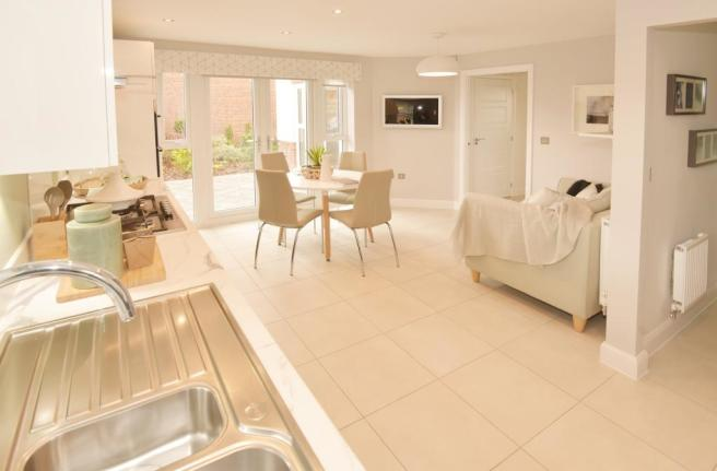 Spacious kitchen with breakfast area, family area and French doors