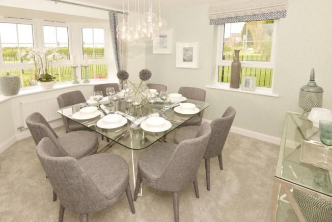 Formal dining area with bay window