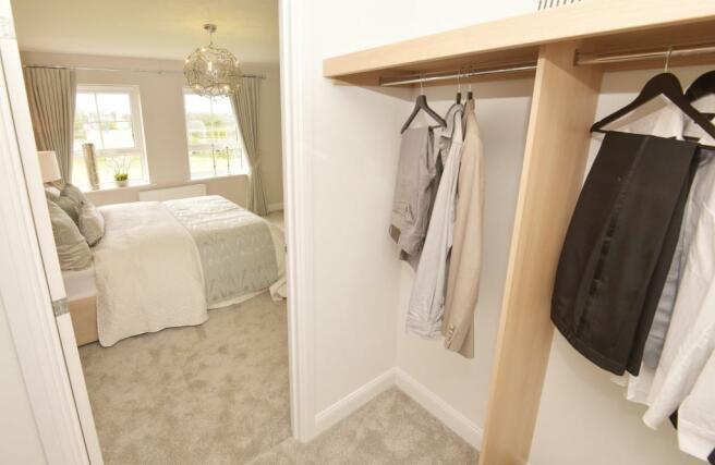 Walk-in wardrobe in the master bedroom