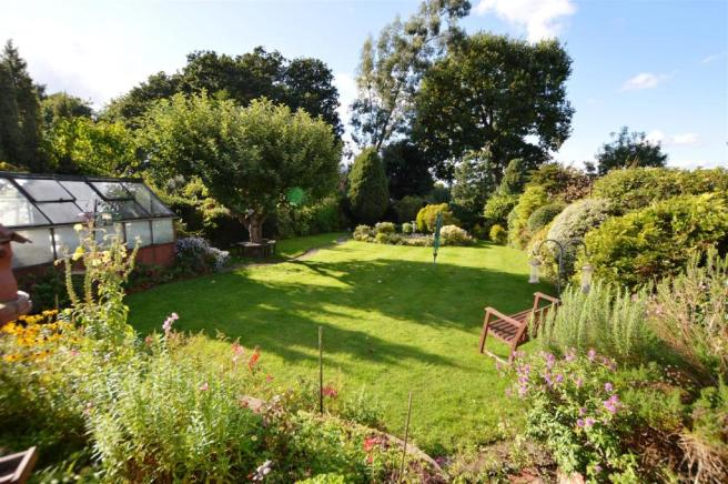 LANDSCAPED LAWNED REAR GARDEN: