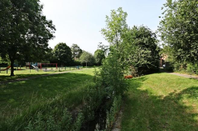 View of nearby brook and play ground