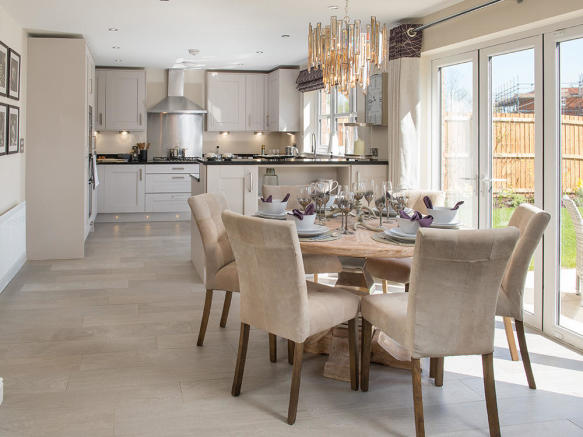 Kitchen and dining area with bi-fold doors to the outside