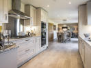 Kitchen/dining/family area with bi-fold doors to the garden