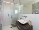 En-suite with Porcelanosa tiles and fitted vanity unit