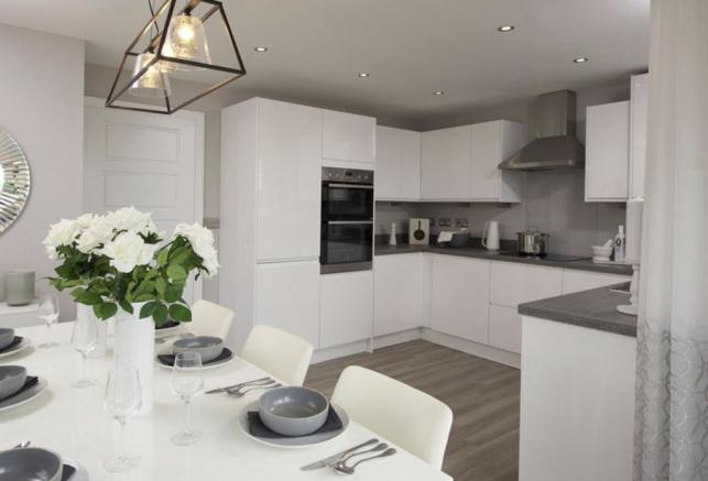 Open plan kitchen with dining