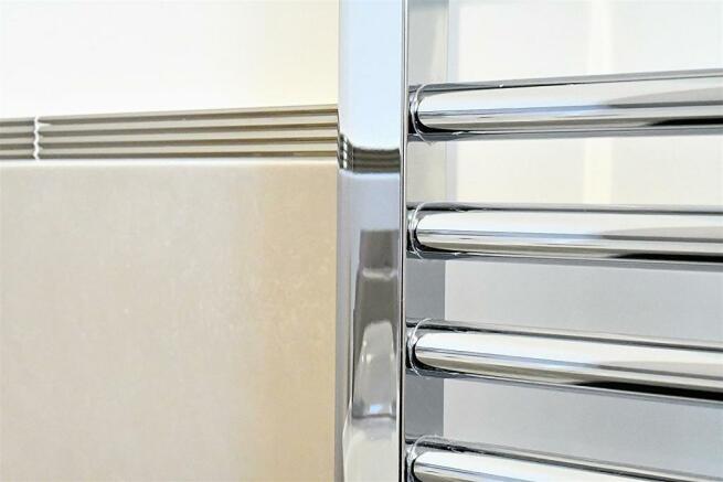 Example chrome heated towel rail