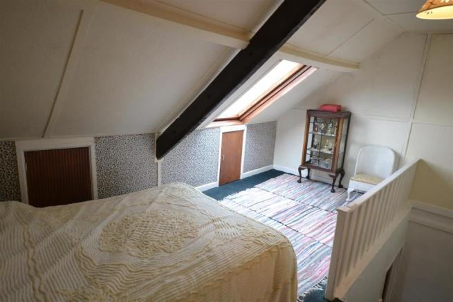 Another view of attic bedroom