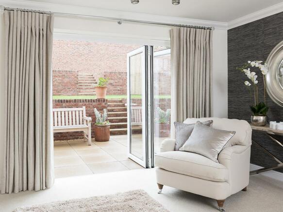 Lounge with bi-fold doors to the patio