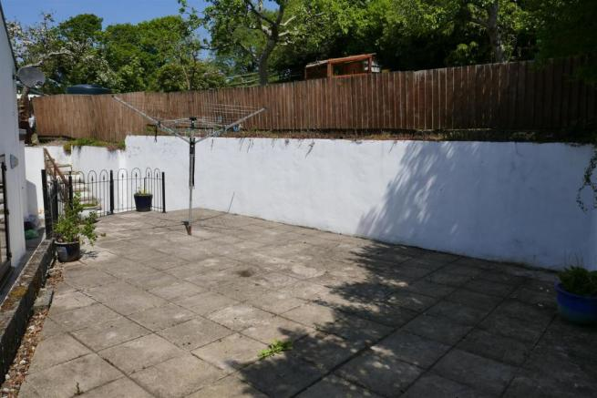 REAR PATIO AND COURTYARD