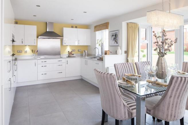 Open-plan kitchen with dining area and glazed bay