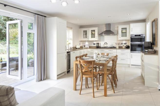 Open-plan kitchen with family/breakfast area and French doors