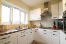 Modern kitchen with integrated appliances.png