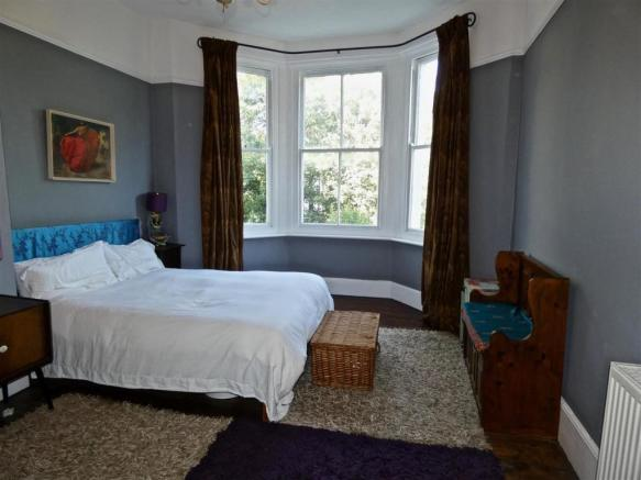 Large bedroom with character bay window.jpg