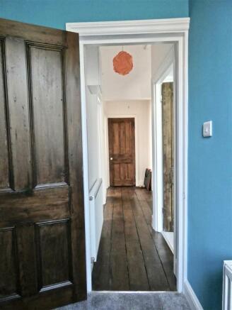 Wide hall with wood flooring.jpg
