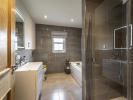 Beautiful family bathroom with extensive tiling