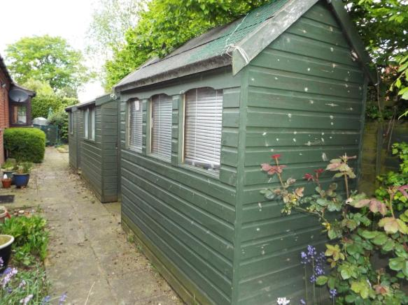 Two storage sheds to