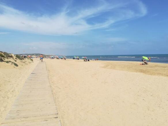 Beach 3-min walk!